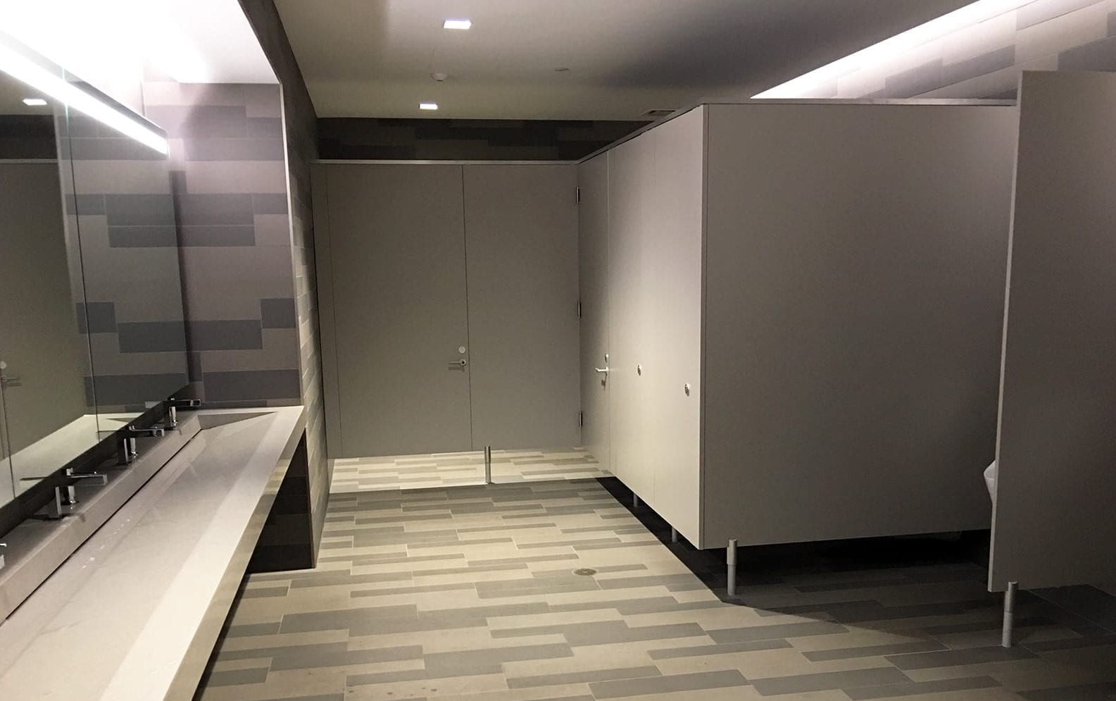 Restroom Featuring Privada Toilet Partitions